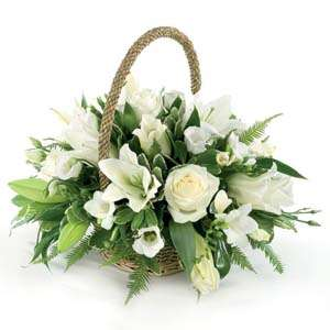 White roses and lilies basket with beautiful fresh flowers