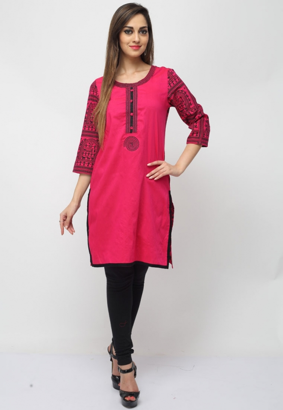 Your ethnic appearance will certainly fetch you endless compliments when you wear this chic pink color cotton designer kurti featuring trendy tribal prints and a lace embellished yoke and border.