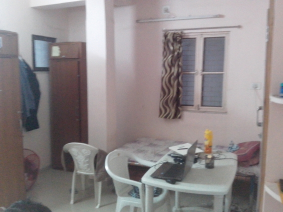 Sharing room with fridge - washing m/c - maid - bedding - tv - furnished kitchen - baroda
