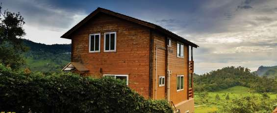 Book the best resort in kotagiri close to coonoor. the wooden cottage is cozy with luxury
